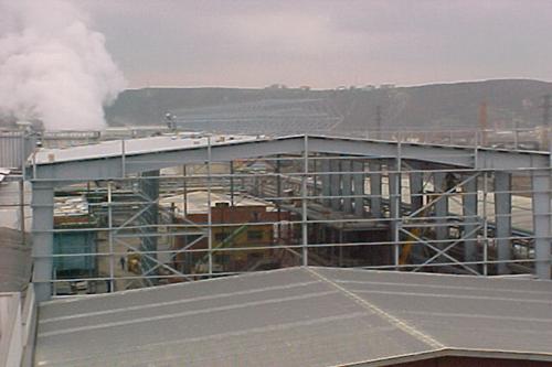 Instalaciones de tratamiento de cenizas y nave industrial de taller eléctrico. Avilés, Asturias, España
