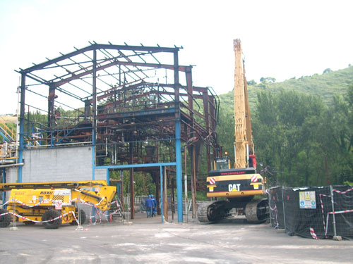 Reconstruction of the damaged unit and storage plant and erection of the new naphtaline plant